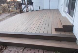 This O'Fallon, Illinois deck features a Timbertech Tigerwood deck with a Mocha picture frame.