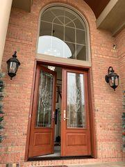 This fiberglass French entry door looks incredible. The decorative glass is truly stunning!