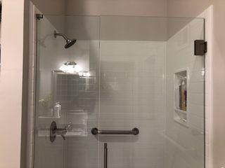 "Photo of the 48"" three hinge frameless shower door."