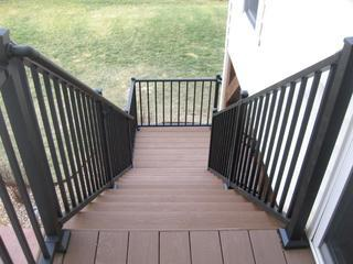 The materials used for these recently installed stairs in Waterloo, Illinois were Timbertech Brown Oak decking with a black Westbury railing.