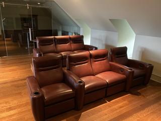 Custom theater room. Check out these beautiful recliners.