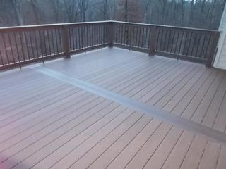 This photo features a Timbertech deck with Brown Oak decking, walnut builder rail, black balusters, and Rustic Elm top cap built in Waterloo, Illinois.