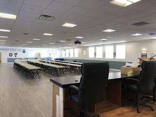 In this large meeting hall to accommodate over 100 members we installed a large projector screen with projector and 2 portable TV's on wheels to move around the room for everyone to see.