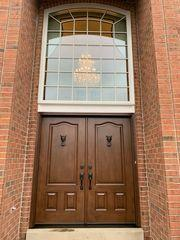 This is a ProVia fiberglass French entry door in the color Nutmeg with custom door knockers selected by the homeowner.