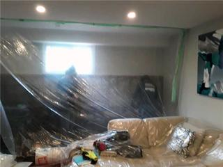 The customers put up a plastic barrier in an attempt to protect their brand-new carpets from water seepage