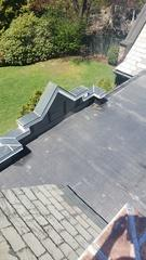 Flat membrane roof which was causing the homeowners multiple leaks.