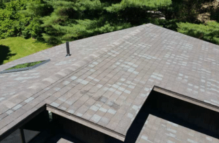 A new roof installation with asphalt shingles on a Stockbridge, MA home.