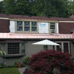 We installed copper ice slides on a roof in Glendale, MA.