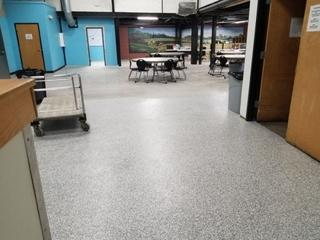 Epoxy floor with custom flake.