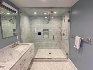 This master bathroom would not be complete without a custom glass shower enclosure and beautiful tiling detail.