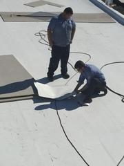 GSM Services works on a commercial roof in Blacksburg, SC.