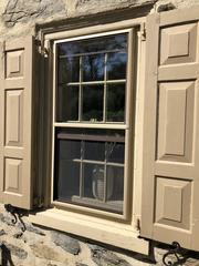 These original wood windows became drafty over time, reducing energy efficiency.