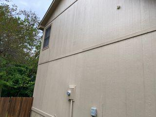 Grooved primed siding installed and painted.