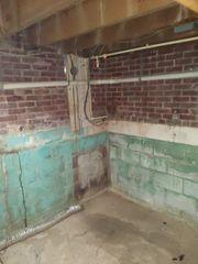 Yikes! This basement has seen better days! DryZone can help with that!