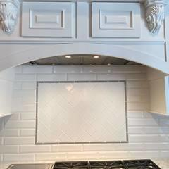 Beautiful tile work now adorns this updated kitchen.