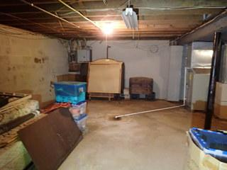 This home's sump pump was right in the middle of the basement! What an eye sore! We installed a new SuperSump Plus sump pump in the corner of this basement and installed our WaterGuard system along the perimeter to keep that water out!