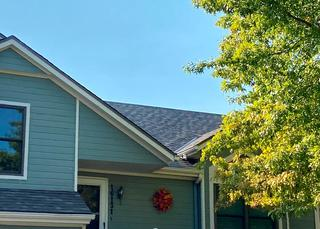 24 squares of Owens Corning Oakridge shingles (driftwood color) installed.