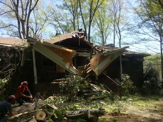 Entryway is destroyed by falling tree