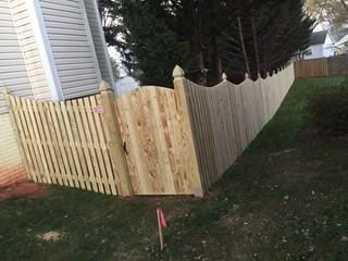 This wood privacy fence was installed for the Hugh residents in Warrenton va to help contain their 3 dogs.