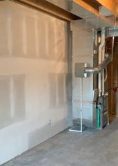 The finished drywall on the shop side of the basement.