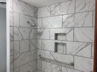 Tile walls in the shower.
