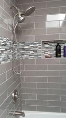 Bull nose and tile walls in shower.