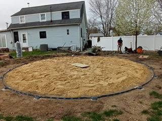 A base layer of sand is put down