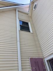 The siding was damaged from too much moisture getting in from the leak on the roof. The window needed to be discarded and covered with new vinyl siding.
