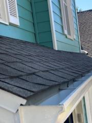 Lansing, KS home needed the old shingles discarded and replaced with Owen Corning Shingles.