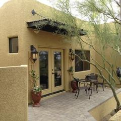 This guest house has a peaceful patio area that is perfect for sitting outside in the morning or evening.