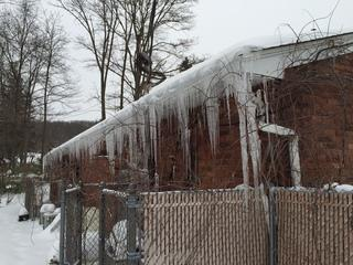 When snow on the roof is melted by heat escaping from the attic, the melted snow re-freezes when it reaches the cold gutter and soffit area, causing ice damming on the roof of your home. This can result in water  leaking in the attic, causing unnecessary  and costly damage.