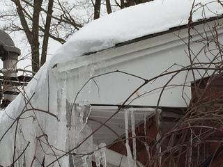 Huge icicles forming around the gutters and eaves can prevent the flow of water, causing even further buildup of ice, which could break the gutter under its weight.
