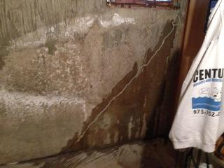 This is a picture of a crack in the homeowners foundation wall.
