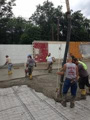 This is a picture of the crew working with the cement on the slab install.