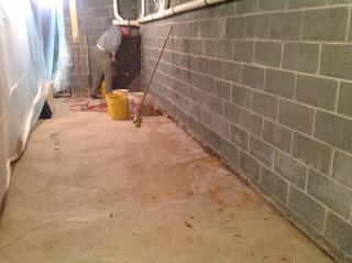 You can see that there are water stains on the floor showing this home has had a water problem.  Once we get done here, this basement will be dry for the rest of its life.