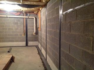 Here you can see the reinforced walls and the WaterGuard in the trench ready for gravel and concrete!