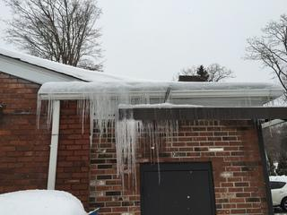 Do you have icicles hanging from your gutters? When the upper area of the roof warms up and melts the snow, the cold eaves freeze the water runoff, forming icicles like the ones seen here.
