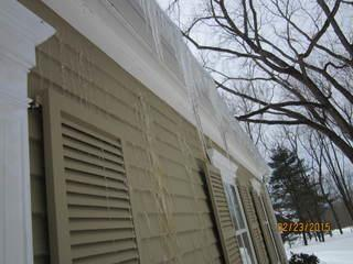 Large icicles hanging off the edge of the roof is a tell-tale sign of ice damming. This Glastonbury home even has icicles forming on the siding!