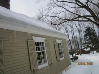 You can see the clogged gutters and icicles forming on the siding of this Glastonbury home. No wonder these homeowners had a problem! Ice dams are essentially the product of melting and re-freezing snow and are definitely a sign of energy loss through the attic