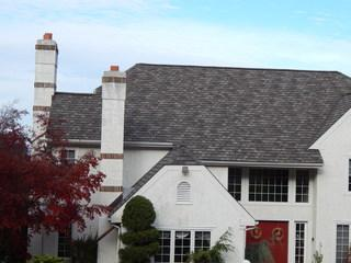 This roof has GAF Camelot II Shingles in Weathered Wood color.