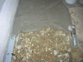 DryZone placed new cement in the homes basement since the old slabs were becoming cracked and moist.