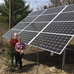 "Ithaca, New York customers, James and Diane, take a minute to pose with their newly installed 12-panel solar array.  When asked why they decided to ""go green"" Diane responded, ""It's good for the environment. Our usage is pretty low as is, but it's just the right thing to do!"" James added that it will be nice not to worry about their monthly bill with all sorts of fluctuations."