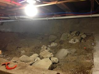 Here you can see the dirt floor in the crawl space.