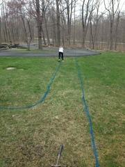 This image shows my daughter helping me lay out the lines for the sidewalk.