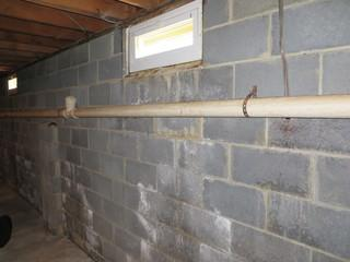 Here is a before picture of the home where the walls are bowed and water stained.
