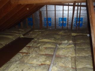 This photo captures the old attic insulation the homeowners was suffering with. Soon the old attic insulation will be stripped and installed with brand new insulation.