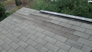 Smart Care Exteriors has been helping repair damaged homes due to Hurricane Sandy, but this is an example of the new shingle not matching 100% with the existing improperly installed roof. After removing the lifted shingle, we properly re-installed the new shingles to the impacted area on this Norwalk, CT roof.