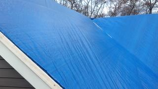 Here's a shot of the tarp we used on this Fairfield home. When we get called on emergency services for homes that are going through insurance, tarping is the first step.