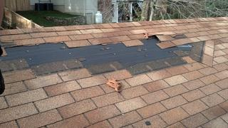 This is another example of a Connecticut home that was impacted by Hurricane Sandy, but there's more to this picture than just roof damage! The problem we immediately noticed, was the placement of the nail. In order to withstand the inclement weather, shingles must be nailed to the roof with specific placement.