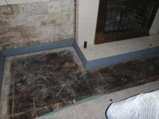 The ruined carpet and wall panels have been cut out. The early stages of one of our drainage systems is also shown.